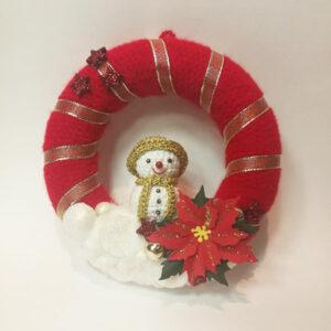 Kvačkan venček za vrata s snežakom