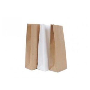 Bela in rjava papirnata vrečka oz. škrnicelj